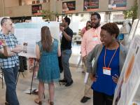 Visitors at a research symposium