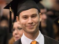 Smiling male graduate