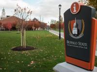 Buffalo State crest mark logo on an outdoor sign