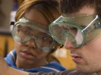 Two students in safety goggles