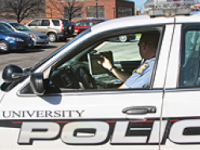 University police officer behind the wheel of police vehicle