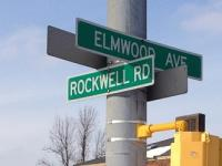 Street sign showing the corner of Elmwood Avenue and Rockwell Road