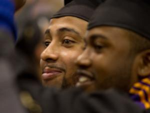 Two smiling students at commencement ceremony