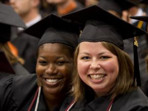 Celebratory graduates at commencement ceremony
