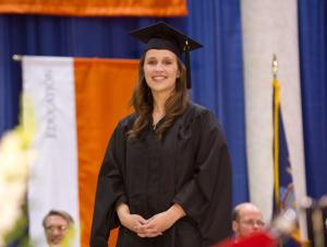 Student on stage in cap and gown