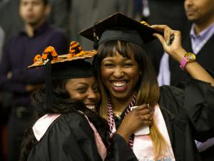 Two students celebrating at commencement ceremony