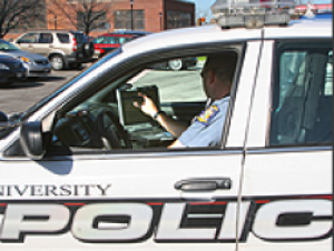 University Police vehicle with officer at the wheel